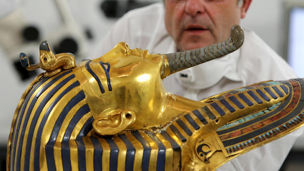 German conservator Christian Eckmann works on the restoration of the golden mask of King Tutankhamun at the Egyptian Museum