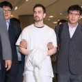 US national Arthur Patterson arrives at Incheon international airport after being extradited from the US for the murder of a South Korean college student in 1997.