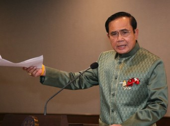 unta chairman Prayuth Chan-ocha speaks to reporters Tuesday at Government House in Bangkok