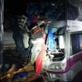 Passengers' baggage lays scattered by the force of the fatal collision between this bus and an 18-wheel truck in Kamphaeng Phet early Tuesday morning
