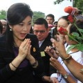 Former Thai Prime Minister Yingluck Shinawatra (R) arrives for her hearing at the Supreme Court in Bangkok, Thailand