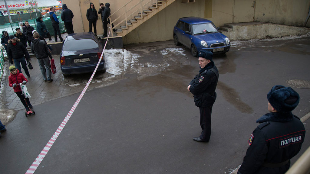 A Russian police officer stands at the site where a woman suspected of murdering a young child was detained, near Oktyabrskoye Pole metro station in Moscow, Russia, February 29, 2016. Reuters/Maxim Zmeyev