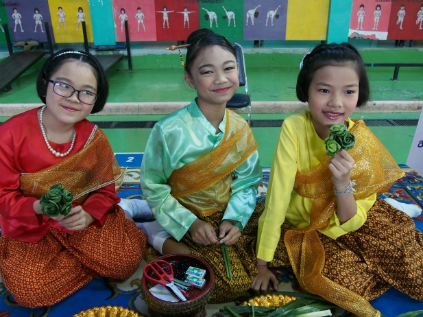 Three elementary school girls at a primary school in Samutprakan, Thailand. This school was one of the pilot sites for the HITAP program for refractive eye screening.