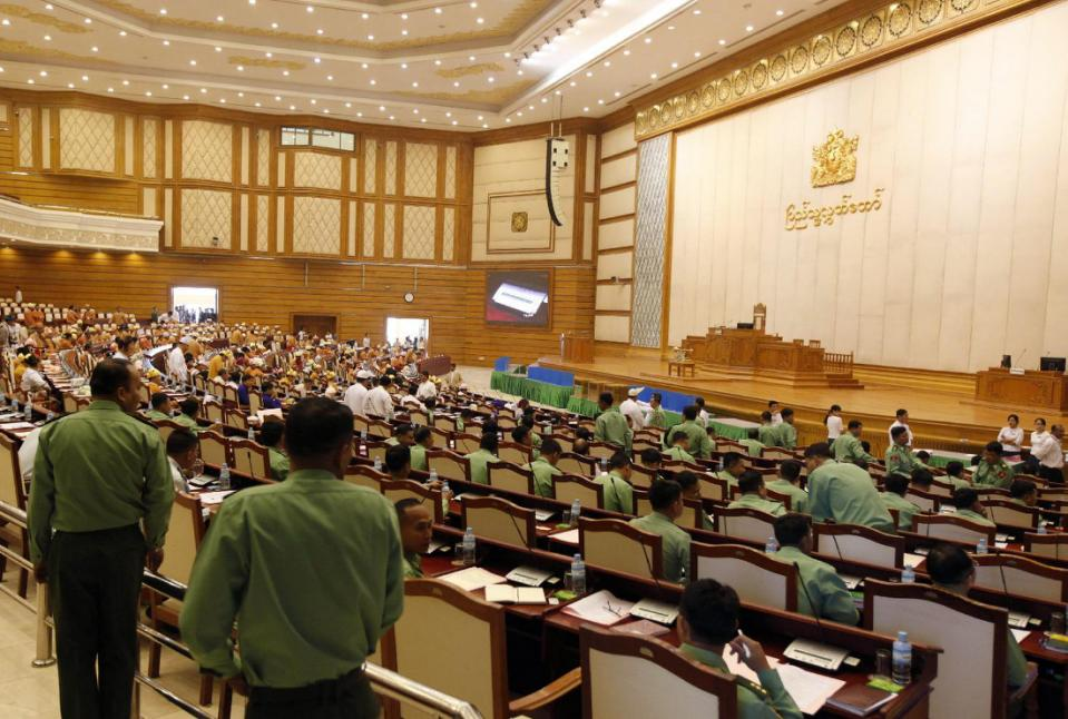 Lawmakers arrive to participate in the inaugural session of Myanmar's lower house parliament Monday, Feb. 1, 2016 in Naypyitaw, Myanmar. Hundreds of newly elected legislators, a majority of them from pro-democracy leader Aung San Suu Kyi's party, on Monday began a parliament session that will install Myanmar's first democratically elected government in more than 50 years. (AP Photo/Aung Shine Oo)