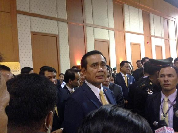Prime Minister Prayuth Chan-ocha responds to questions from reporters after explaining updated foreign investment regulations