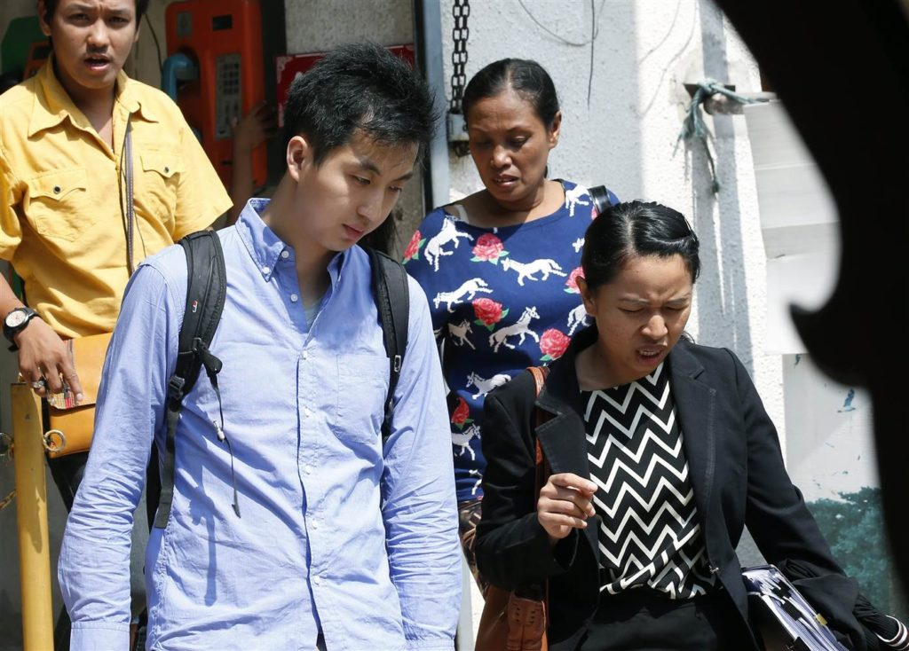 Hong Kong-based photojournalist Anthony Kwan (L) walks next to his Thai lawyer (R) at Samut Prakan provincial court, on the outskirts of Bangkok