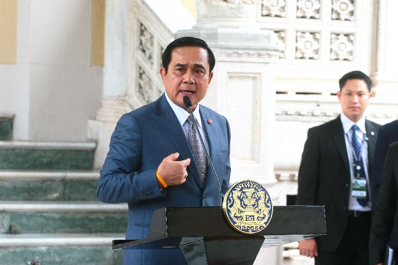 Prayuth speaking to reporters at the Government House in Bangkok