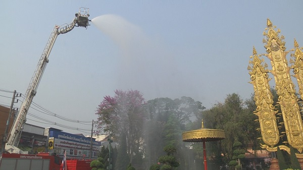 A fire crew sprays water Monday in Chiang Rai city.