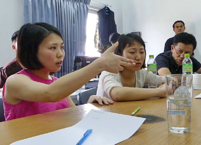 Chinese women provide testimony to police Tuesday at a Pathum Thani police station.