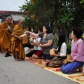 Participants offered food and sticky rice to 60 monks, a common Laos' tradition that is practiced by communities along the Mekong River