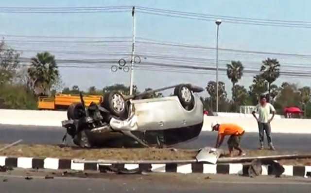 Workers clean up accident scene after road accident involving Australian Ambassador's Daughter in Petchaburi Province