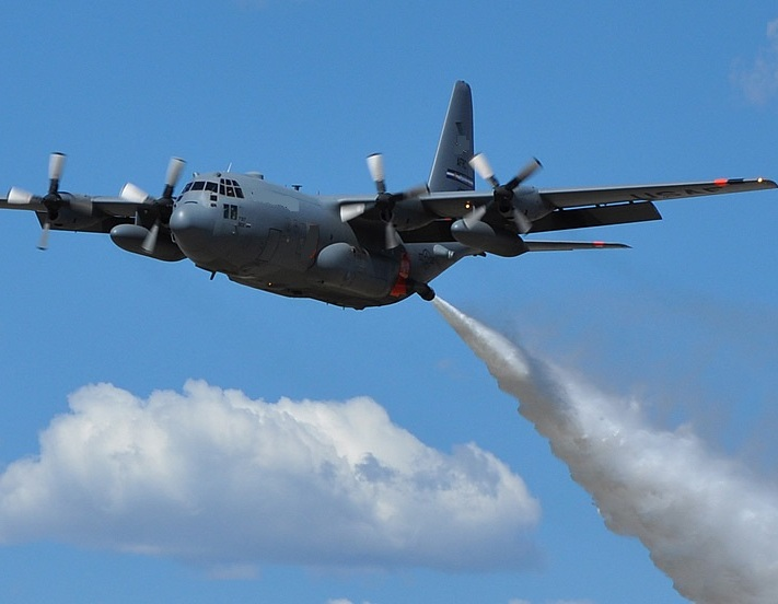 C-130 Hercules expels water, Thai Air Force planes will spray water over haze-cloaked northern Thailand- File Photo