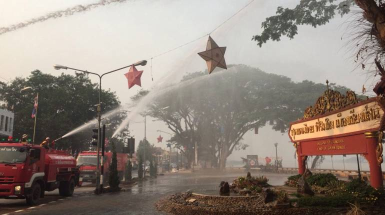 Authorities are spraying water widely to reduce haze and increase humidity levels