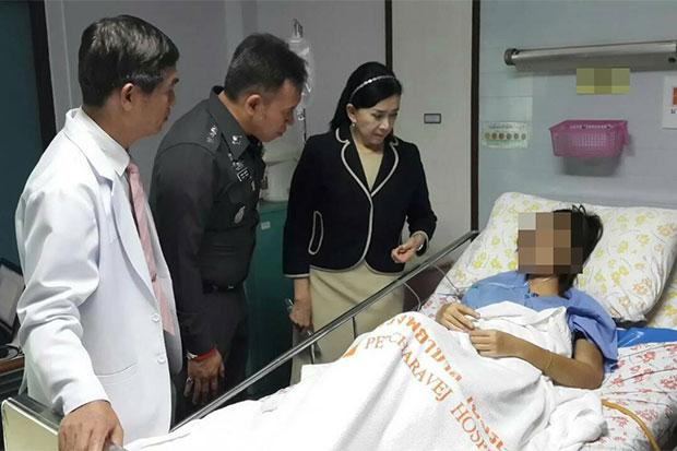 Pavena Hongsakula, chairwoman of the Pavena Foundation for Children and Women, a senior police officer and a doctor, visit the university student who sustained serious injuries to her face, lungs and ribs after being assaulted by her bodybuilder boyfriend