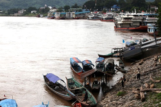 Chinese river boats tied up in the port in Chiang Saen due to low Mekong River levels