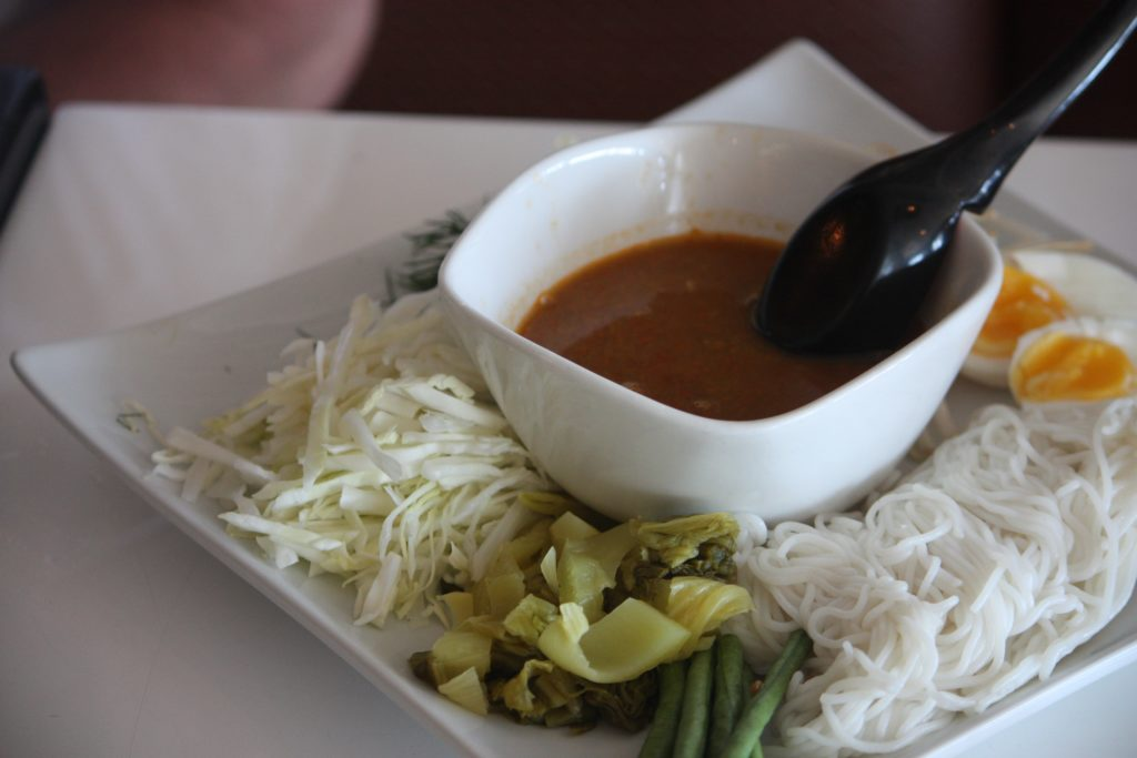 Kanom jeen is normally served with curry or several sauces