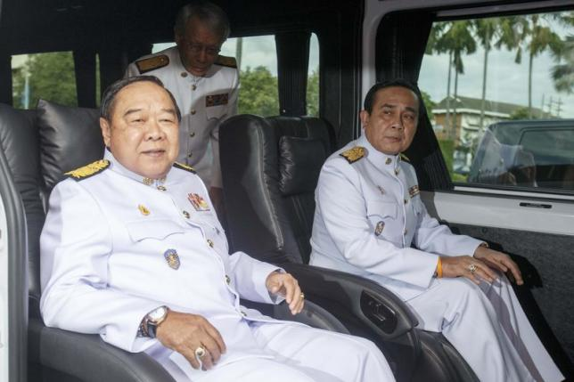 Thailand's Prime Minister Prayuth Chan-ocha (R) and Deputy Prime Minister and Defence Minister Prawit Wongsuwan (L) leave Government House