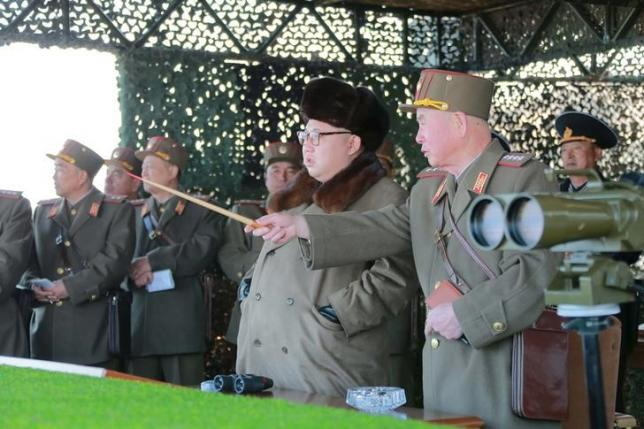 North Korean leader Kim Jong Un watches landing and anti-landing exercises being carried out by the Korean People's Army (KPA) at an unknown location