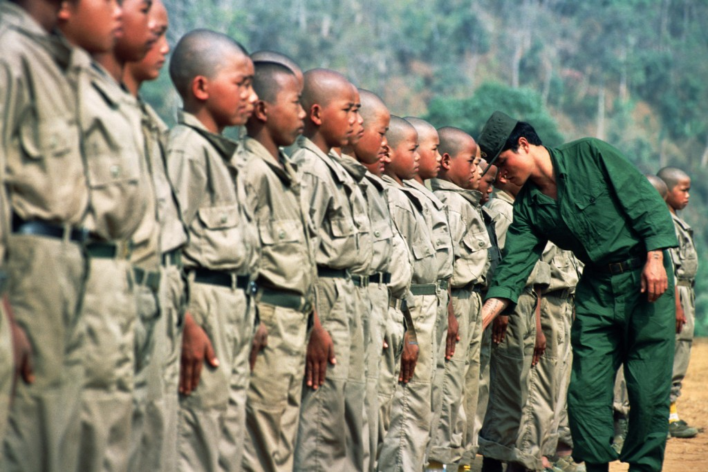Child-soldiers of the Mong Tai Army (MTA), drug warlord Khun Sa's army, during tough training with their commander.