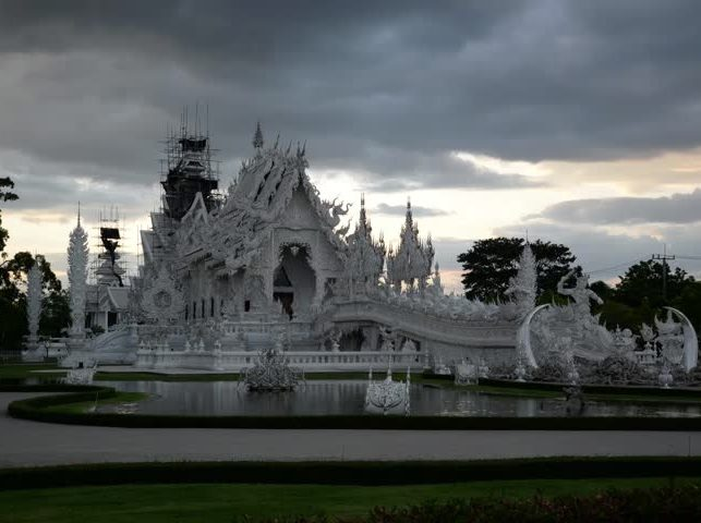 "Dark storm clouds hover over Wat Rong Khun""White Temple"" in Phan Chiang Rai"