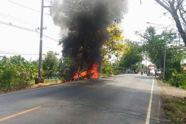 Flames engulf the van after the fatal accident in Prachin Buri on Monday afternoon. (FM. 91 Traffic Pro photo)
