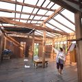 A woman shows the roof of her house in Phrae blown away by a storm on Monday night. (Photo by Taweesak Sukkasem)