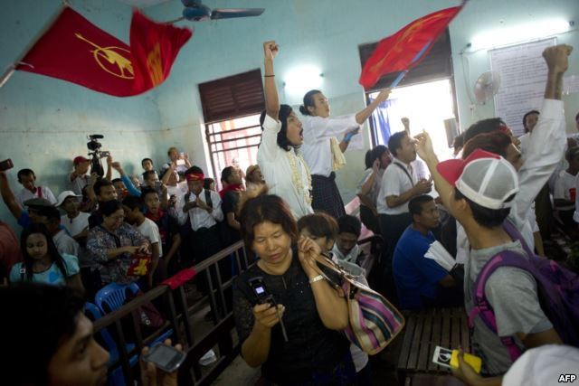 Newly-released political student protesters and family members shout and cheer after their release in Tharrawaddy town, Bago Region in Myanmar on April 8, 2016.