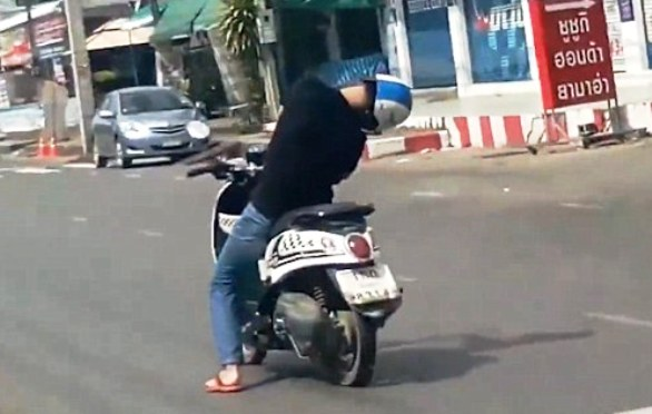 WATCH VIDEO: Sleeping Man Rides Scooter through Streets of Thailand
