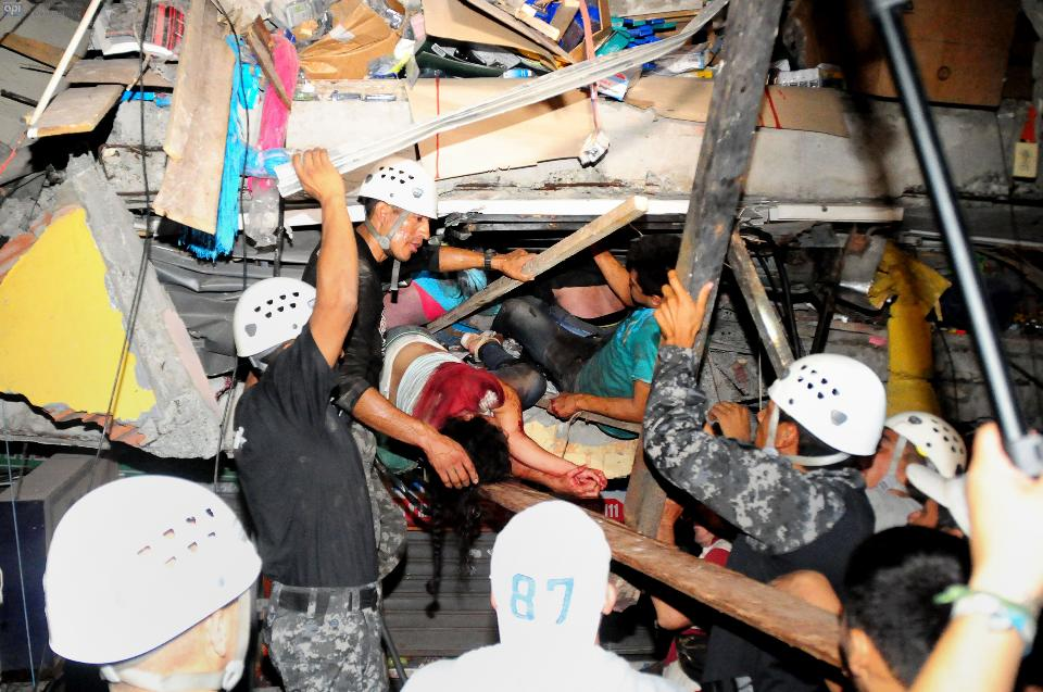 Ecuador Earthquake: Rescue workers work to pull out survivors trapped in a collapsed building after a huge earthquake struck
