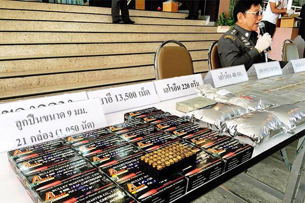 48 kilograms of compressed heroin, 13,500 ecstasy pills and 1,050 rounds of 9mm ammunition seized from four accused drug traffickers are displayed during a media briefing at the Narcotics Suppression Bureau on Saturday