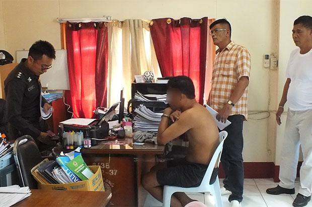 Khongsak Jitchamruang, 46, (handcuffed without shirt) is questioned by police about the alleged rape of his 13-year-old stepdaughter and forcing her to take speed pills