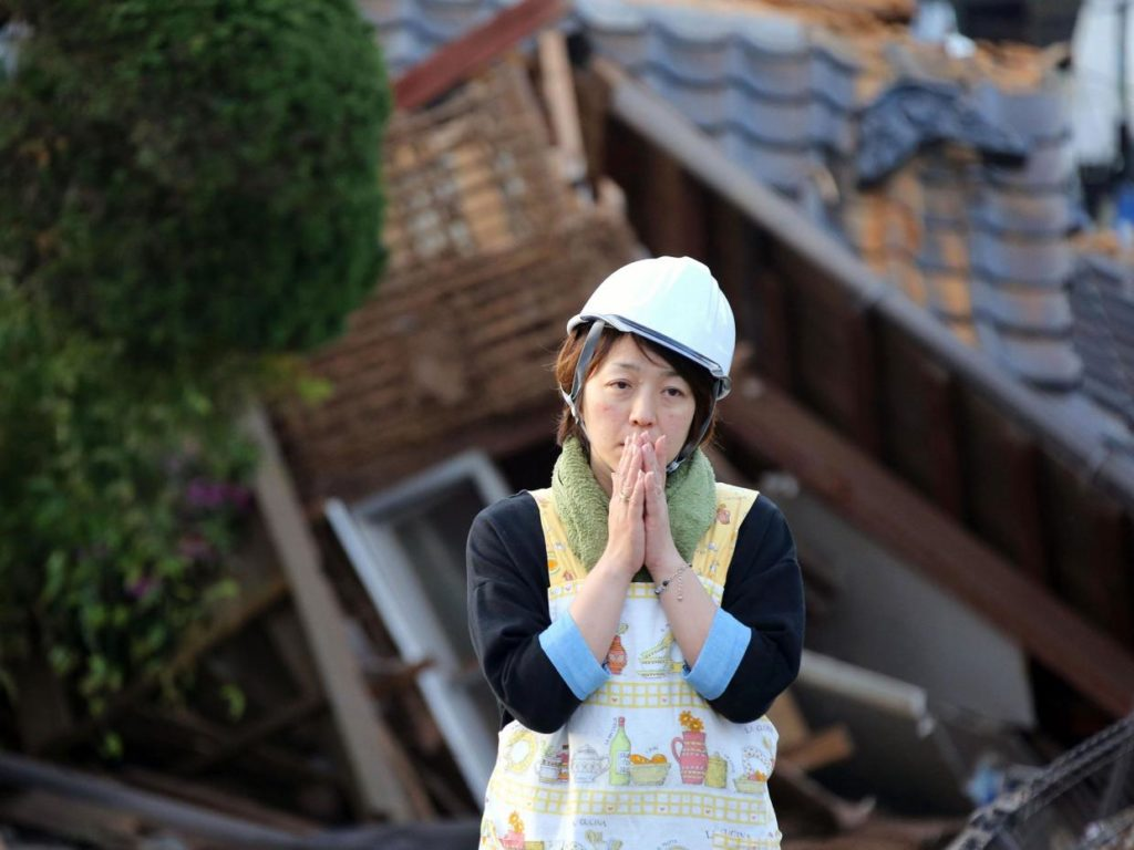 A resident stands in front of a damaged house in Mashiki, Kumamoto prefecture, southern Japan.