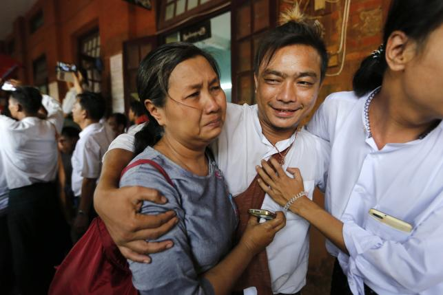 A student protester (C) and his family member cry after he was released by the new government's general amnesty at Tharrawaddy court, Tharrawaddy, Bago division April 8, 2016. REUTERS/Soe Zeya Tun