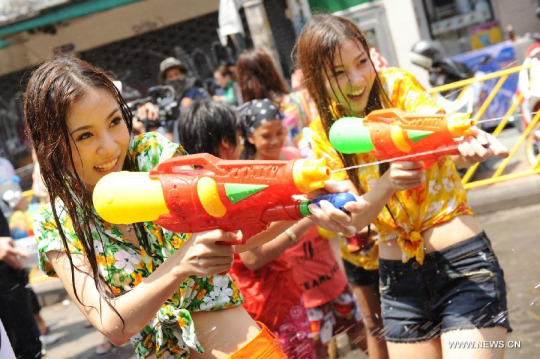 Revelers line the streets, or prowl the roads in pickup trucks, armed with buckets, water guns or hoses and douse anyone in sight
