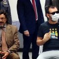 Mauro Vincenzo Saguato, 65, (left) an Italian national wanted by Interpol for embezzlement in his home country, and Marian Nicolau, 36, the accused leader of a Romanian skimming gang,appear at a media briefing at the Immigration Bureau on Wednesday