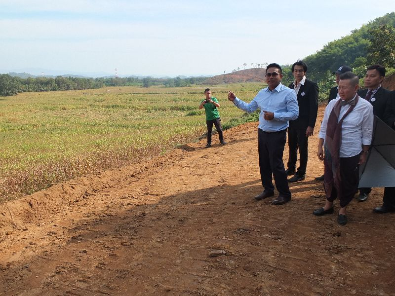 Trin Nilprasert tours the site in Chiang Rai province on Monday where the world's tallest flagpole is reportedly being built