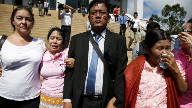 May Thein (2nd L), the mother of Win Zaw Htun, cries with the mother of Zaw Lin as they leave after hearing the verdict at the Koh Samui provincial court in Koh Samui, Thailand, December 24, 2015. A Thai court sentenced two Myanmar migrant workers to death on Thursday after convicting them of the 2014 murders of two British tourists on a holiday island in a case mired in controversy. REUTERS/Athit Perawongmetha      TPX IMAGES OF THE DAY