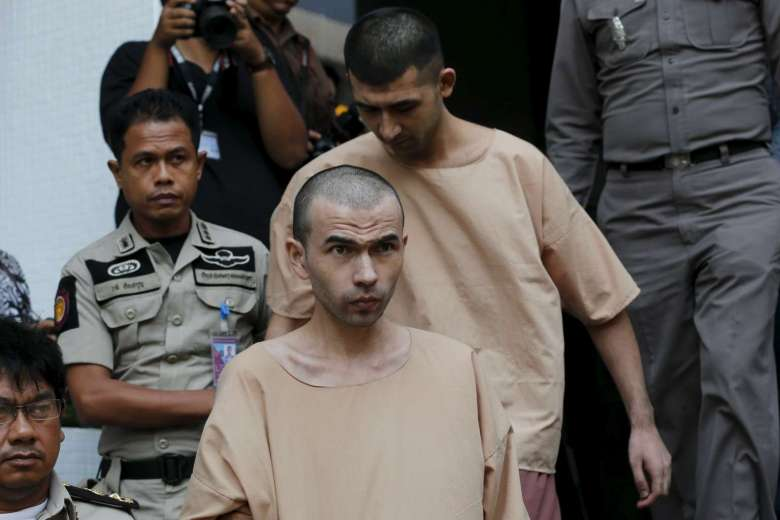 Bangkok blast suspects Adem Karadag (front) and Yusufu Mieraili are escorted by prison officers as they leave the military court in Bangkok, Thailand on April 21, 2016. PHOTO: REUTERS
