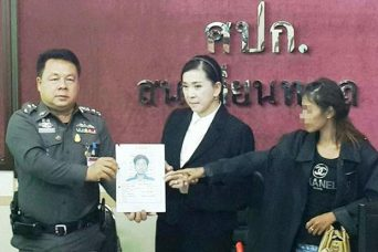 The 24-year-old mother (right) identifies a picture of her husband Anucha Kaewpradit, 34, as the man who beat her two-year-old daughter to death at their home in Bangkok