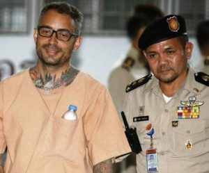 Segarra Princep, left, is escorted by prison personnel as he arrives to the Criminal Court in Bangkok on Wednesday