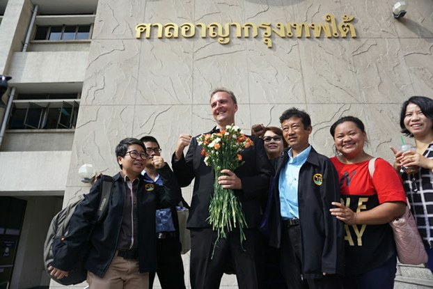 Labor-rights activist Andy Hall (center) gathers with supporters outside the Bangkok South Criminal Court, May 19, 2016.