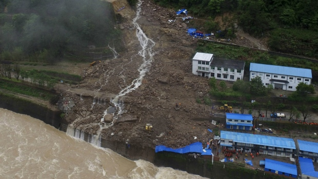 An aerial view shows a building and workers' dormitory damaged by a landslide in Taining county in southeast China's Fujian province