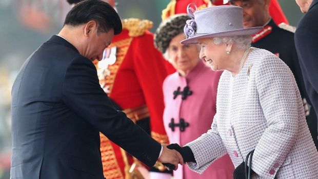 Britain's Queen Elizabeth II , right, as she greets Chinese President Xi Jinping, during the official ceremonial welcome for the Chinese State Visit, in London.
