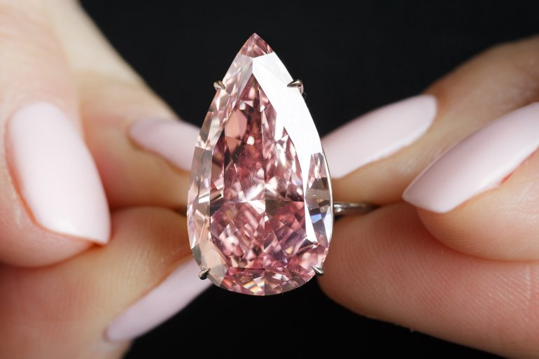 An extremely rare 15.38 carat pear-shaped pink diamond -- called the 'Unique Pink' -- sold for $31.6 million at Sotheby's in Geneva on Tuesday (May 17, 2016), making it the most expensive fancy vivid pink diamond ever to sell at auction.