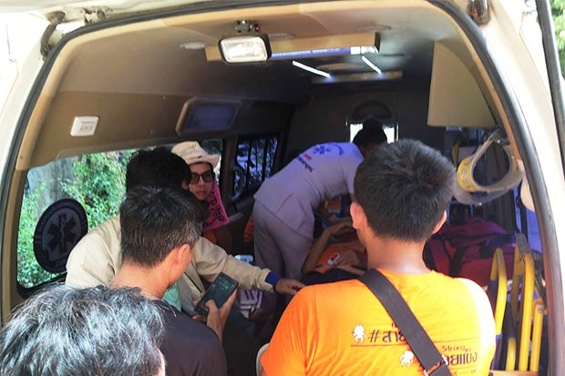 Mr Saito is treated in an ambulance before being taken to hospital. (Photo by Piyarach Chongcharoen)