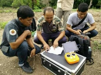 Rescuers in Chanthaburi check a map Sunday before they resumed searching for a military helicopter that disappeared in the province.// Chanthaburi rescue operation centre.