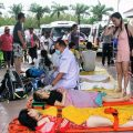 Injured tourists are taken to a pier in Phuket before being transferred to hospitals following the fatal collision between two speedboats off Phuket on Wednesday. Two tourists were killed. (Photo Achadtaya Chuenniran)
