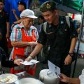 As part of that campaign, students from the military's territorial defence programme are visiting public places, including markets and shopping malls, to persuade people to vote.