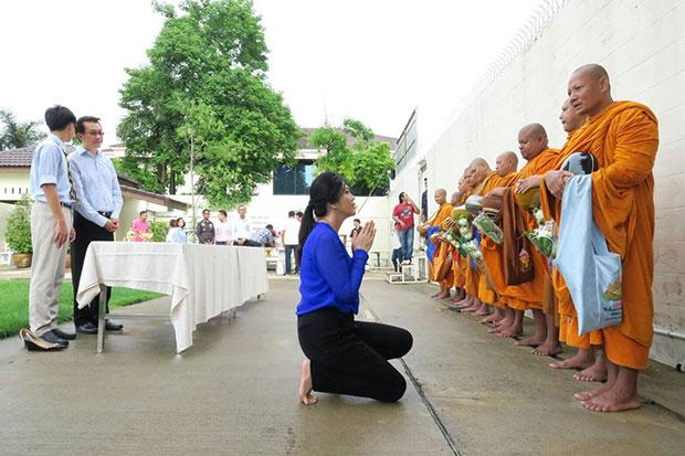 Yingluck Shinawatra at the morning alms giving ceremony at her home on Yothin Pattana Soi 3 as she celebrates her 49th birthday on Tuesday.