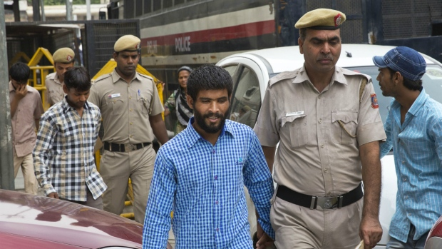 Three of the five convicts in the gang rape of a 51-year-old Danish tourist in 2014, are escorted by the police for a hearing at a city court, in New Delhi, India on Thursday, June 9, 2016. (AP / Manish Swarup)